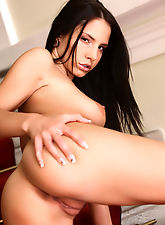Stylish Monika will grip your heart in both hands as she shows you her long strong legs and what is in between.