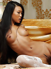 Hot Asian lass who has long hair and a lean tanned body she also has a tasty puffy pussy