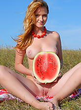 nude teen, Adorable cutie enjoys her picnic with watermelon and shows off her perfect tits and pussy.