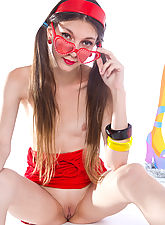 Gorgeous teen girl with red glasses posing with tape recorder