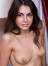 Curly small tits brunette posing naked on the couch