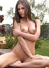 nubile videos, Teasing girl strips naked and spreads wide outdoors